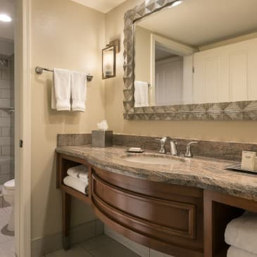 Our marble bathrooms provide spacious showers/bath tubs and luxury amenities.