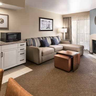 Relax in our spacious living and dining areas in our double queen rooms.
